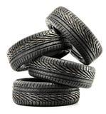 Four new black tires on white. Background Stock Photo