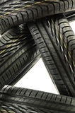 Four new black tires on white Stock Images