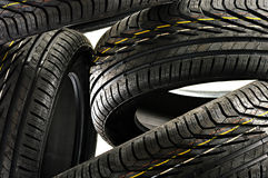 Four new black tires on white Royalty Free Stock Images