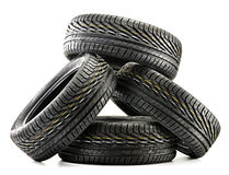 Four new black tires on white Stock Photography