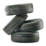 Four new black tires on white Royalty Free Stock Photos