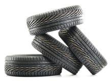 Four new black tires on white Stock Photo
