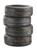 Four new black tires on white Stock Images