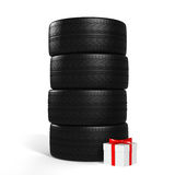 Four New Car Tires and White Gift with Red Ribbon On the White Royalty Free Stock Photo