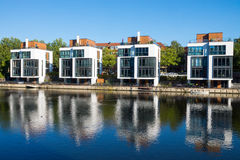 Four new houses at the waterside Royalty Free Stock Images