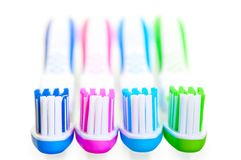 Four new multi-colored toothbrushes are Stock Photography