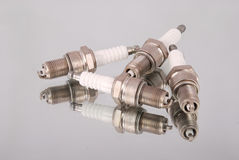 Four new spark plugs Royalty Free Stock Image