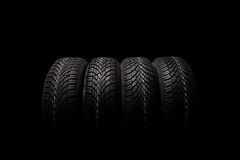 Four new tires isolated on black background Stock Image