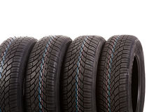 Four new tires isolated on white background Royalty Free Stock Photography