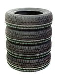 Four new tires stacked on white background Royalty Free Stock Images