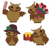 Four nice owls with different objects Stock Images