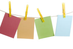 Four Notecard hangs on clothesline. Notecard with copy space hangs on clothesline - spring colours Stock Images