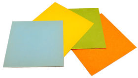 Four notes. On white background (isolated) - blue, yellow, green, orange stock photos