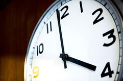 Four o'clock. Close up clock on wall at time four o'clock Royalty Free Stock Images