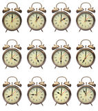 Four oclock. Vintage alarm clocks set for 12 hours of the day, great for any sort of time related image Stock Photography