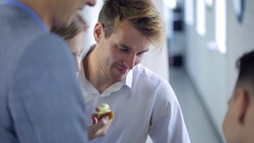 Four office workers friendly talk with each other during break. stock footage