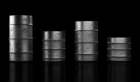 Four oil barrels on dark background Stock Image