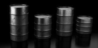 Four oil barrels on dark background Royalty Free Stock Photos