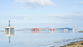 Four oil rigs in the Cromarty Firth. Royalty Free Stock Images