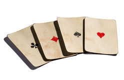 Four old aces cards Stock Images