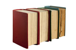 Four old books. In row isolated on white royalty free stock photo