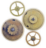 Four old brass gears isolated on white. Background Royalty Free Stock Images