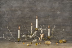 Four old burning advent candles on wooden rustic christmas backg Stock Photography