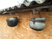 Four old cauldrons Royalty Free Stock Photos