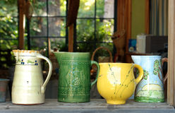 Four Old Ceramic Pitchers Royalty Free Stock Photography