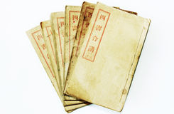 Four old Chinese books. On white background stock photography