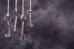 Four old keys hanging Stock Image