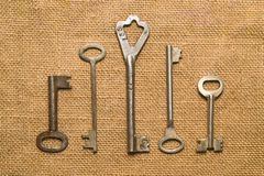 Four old keys to the safe on a very old cloth Stock Photo