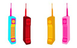 Four old multicolored button retro Hipster vintage square first mobile phones with a long antenna.  Stock Image