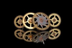 Four old rusty clock gears. On a black background Stock Photo