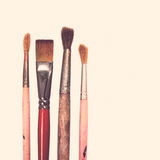 Four old used paintbrushes on white background Stock Photography