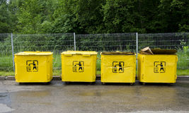 Four old yellow trashcans Royalty Free Stock Photo