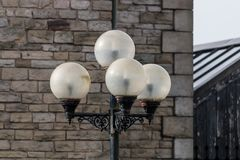 Four Opaque Lights. Four spherical opaque lights on a metal pole royalty free stock images