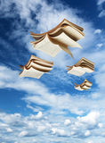 Four open books flying above Royalty Free Stock Photography