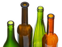 Four open bottlenecks of colored wine bottles Royalty Free Stock Photo