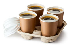 Four opened take-out coffee in holder. Standing on a white Royalty Free Stock Photography