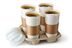 Four opened take-out coffee in holder. Standing on a white Stock Images