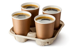Four opened take-out coffee in holder Stock Image