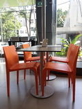 Four Orange Chairs with a Dinning Table Stock Photos
