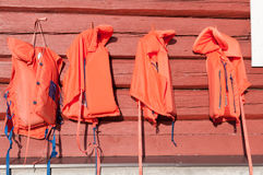Four orange lifejackets Royalty Free Stock Images