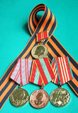 Four orders. Four medals at gerogievskoy tape glory Stock Images