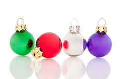 Four Ornaments on White - Red Fallen Over Royalty Free Stock Photography