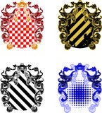 Four Ornate and Grunge Shields Royalty Free Stock Images