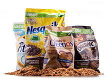 Four packages of Nestle breakfast cereals isolated on white Royalty Free Stock Photos