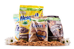 Four packages of Nestle breakfast cereals isolated on white. POZNAN, POL - MAY 5, 2017: Nestlé is a Swiss transnational food and drink company headquartered in Royalty Free Stock Image