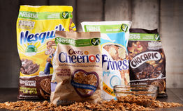 Four packages of Nestle breakfast cereals. POZNAN, POL - MAY 5, 2017: Nestlé is a Swiss transnational food and drink company headquartered in Vevey, Vaud Stock Images